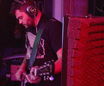 Koudi Wyoming Tracking Guitars at The NoiseRoom Studio.jpg