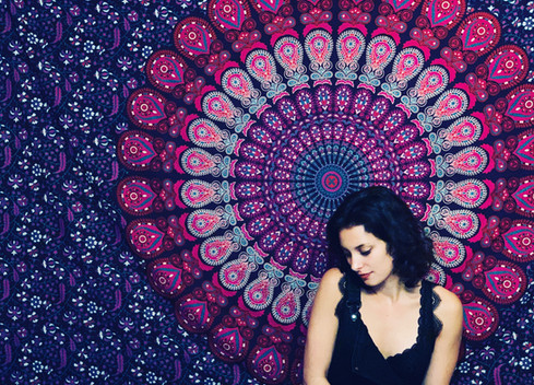 KYRIAKI in front of a tapestry.JPG