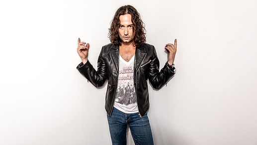 Constantine Maroulis pointing up.jpg
