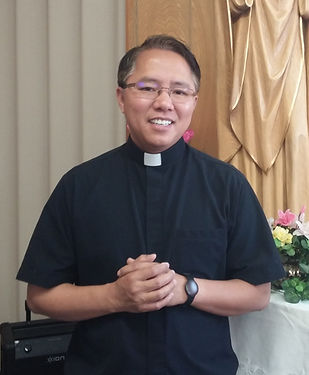 Father Trieu with Roman Collar.jpg