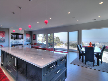 kitchen island, red accents, bay area view, great room