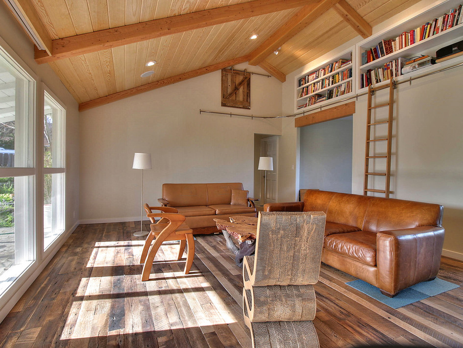 living room, library, vaulted ceiling, beams, sliding ladder