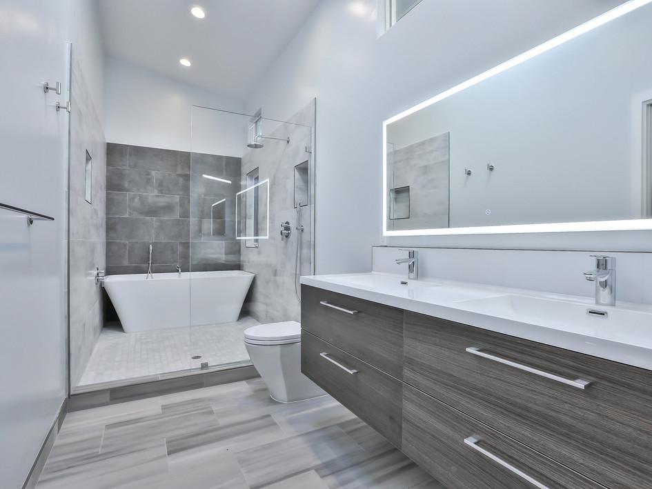 master bath. wet room, floating vanity, double vanity, backlit mirror, soaking tub