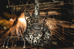Guitar with sparks in background
