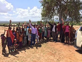 Raising hands after service in the bush