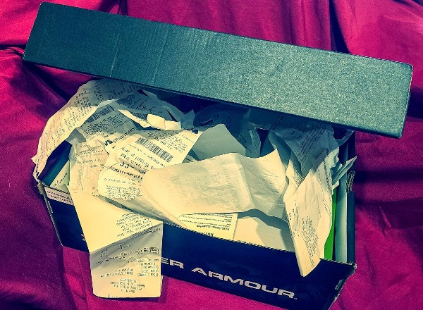 shoebox of receipts disorganized and unprepared for taxes
