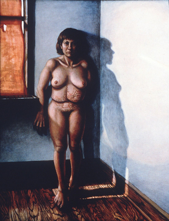 A self portrait in the medium of acrylic on wood. Riva is standing in the corner of a bare room with wooden floors. A torn window shade to the left side of the artwork casts light against her nude body and creates a shadow of her profile on the opposite wall. Riva has chin length hair with bangs and stares defiantly at the viewer. A faint compass rose tattoo sits above her pubic area. Her abdomen is marked with multiple scars.