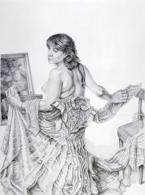 A self portrait in the medium of graphite on board. Riva stands in the middle of the image, one knee up on a chair, with her bare back turned to the viewer. She turns to the left and looks over her shoulder so that her face is visible. Her hair is medium length, layered, with a braid of longer hair falling down her back. Riva clasps a lacy long-sleeved wedding dress behind her. She holds it up with her arms so that is covers her lower body. Behind Riva is a large framed mirror that reveals a distorted view of her nude front body. Two wooden chairs sit on either side. The floor and wall around her are completely white.