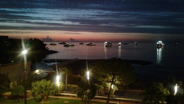 Dusk Larvotto bay, Monaco, yacht show week