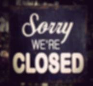 Vintage metal closed sign on shop door.j