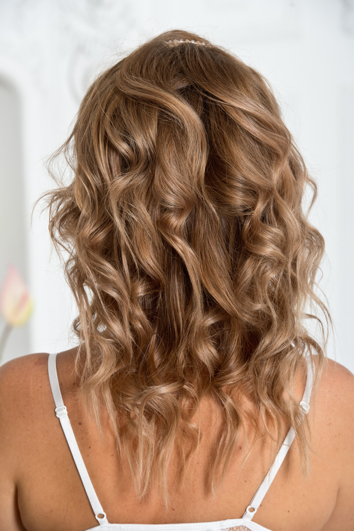 Curly hair. Healthy female hair. Hairsty