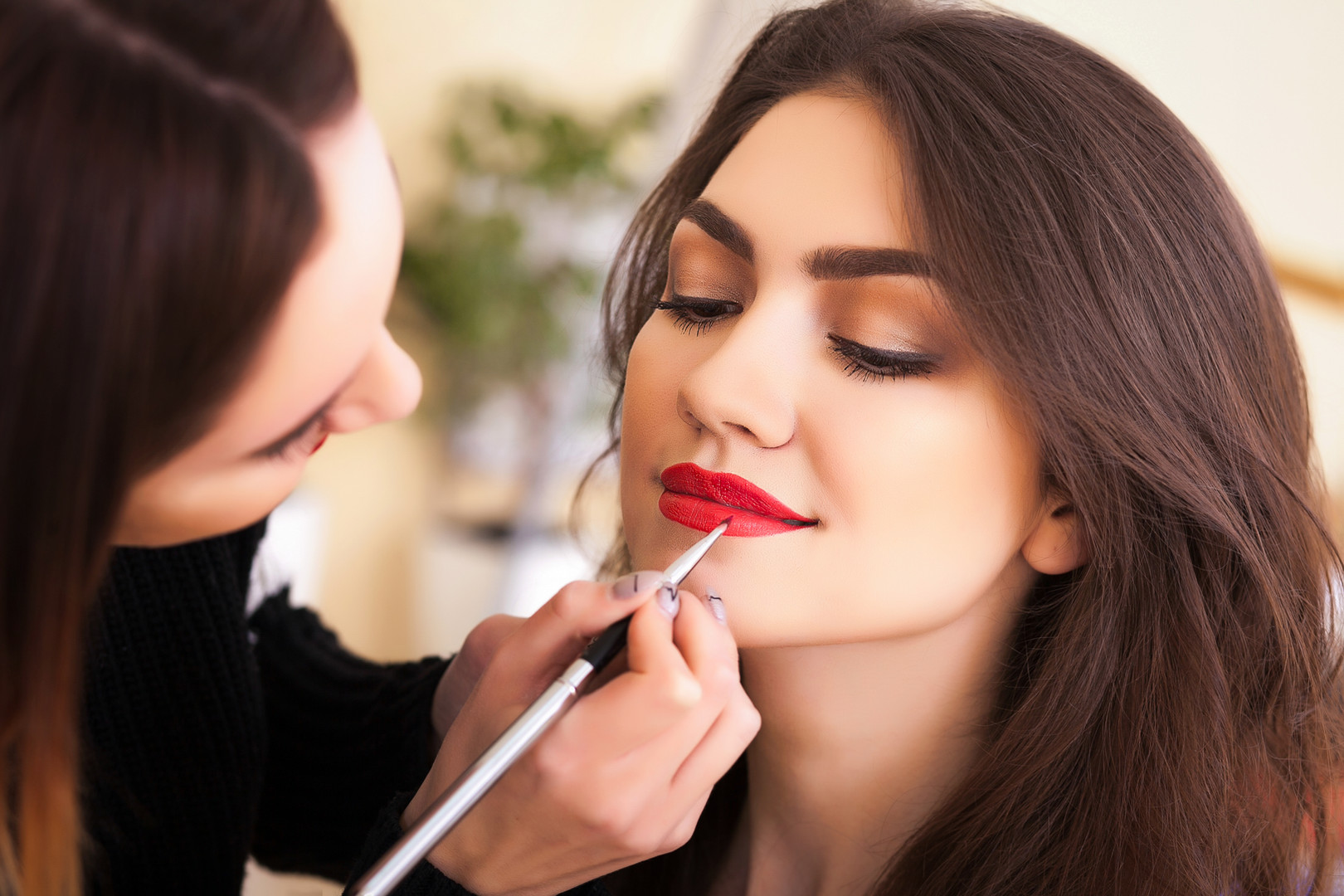 make-up artist doing make-up girl in the