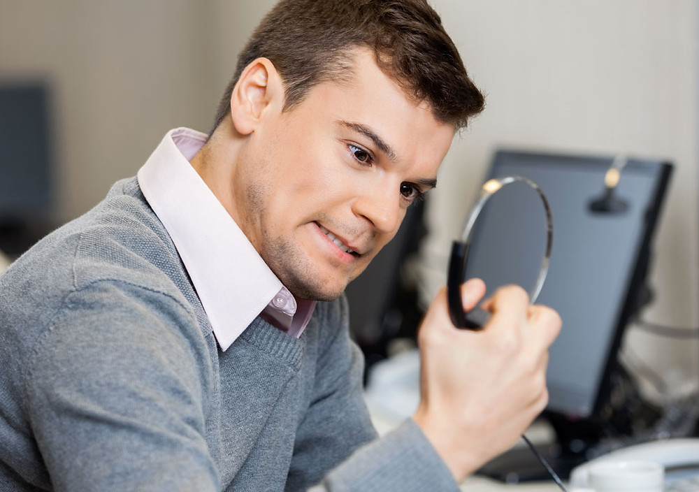 Call centre agent looking stressed and squeezing headphones