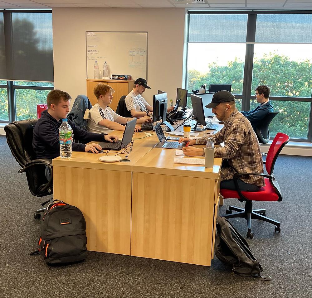 XL Marketing Web Development Team working at their desks