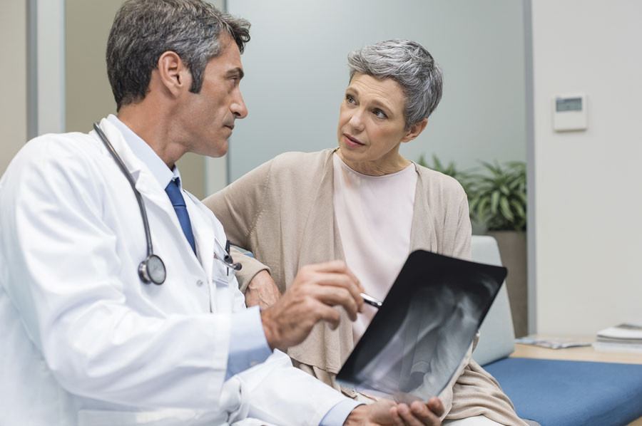 Doc consults with patient