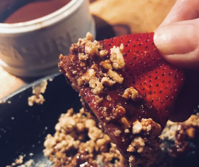 Dipping strawberry in nuts