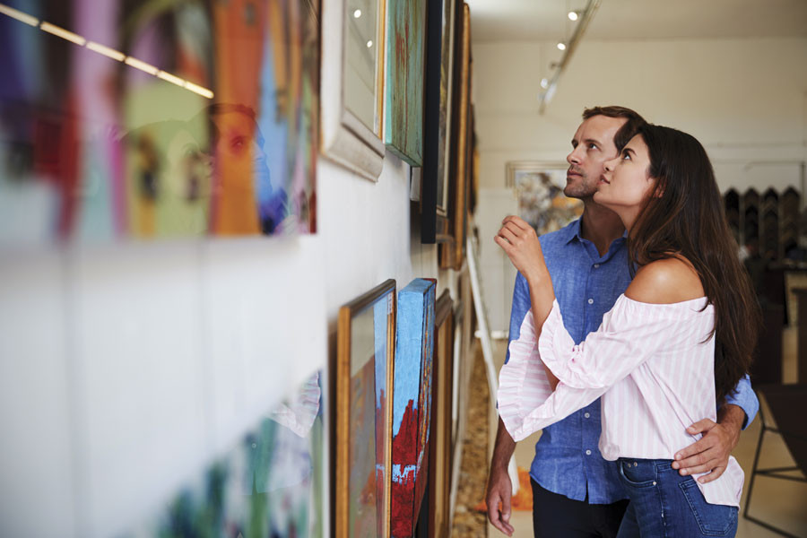 couple looking at paintings