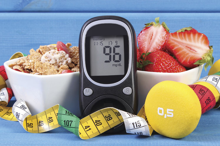diabetic glucose measurement surrounded by fruits and cereal