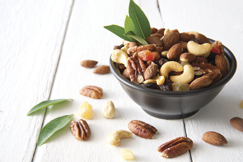 nuts spilling out of a bowl snacks for cocktail hour