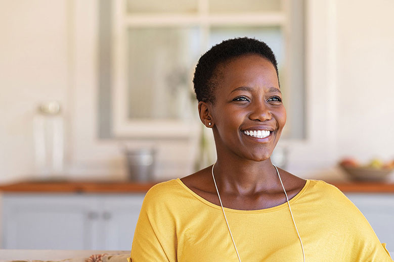 smiling black woman exuding confidence and talent