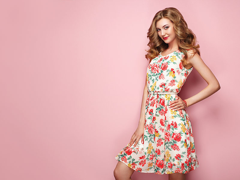 young female model shows off a stylish print dress