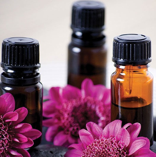 flowers and brown bottles of oils