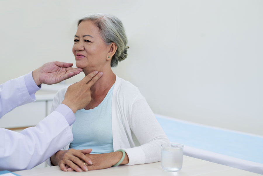 Doctor examines thyroid