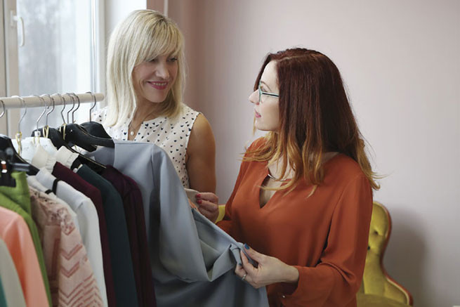 women looking at clothes
