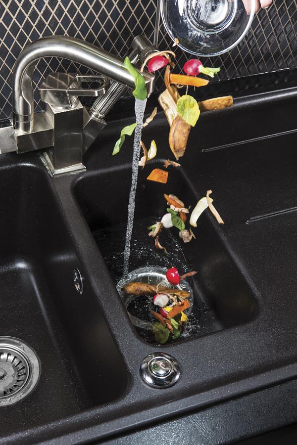 Putting food scraps into disposal