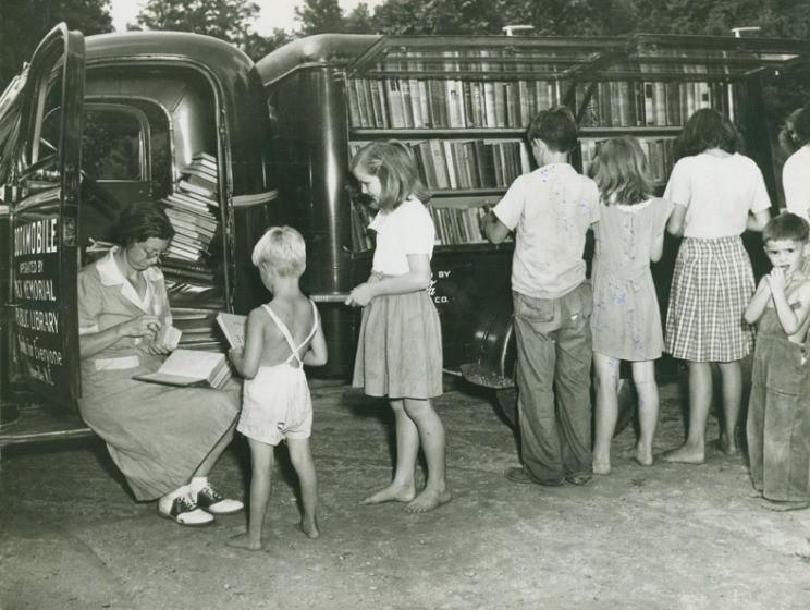 Barefoot kids getting library books