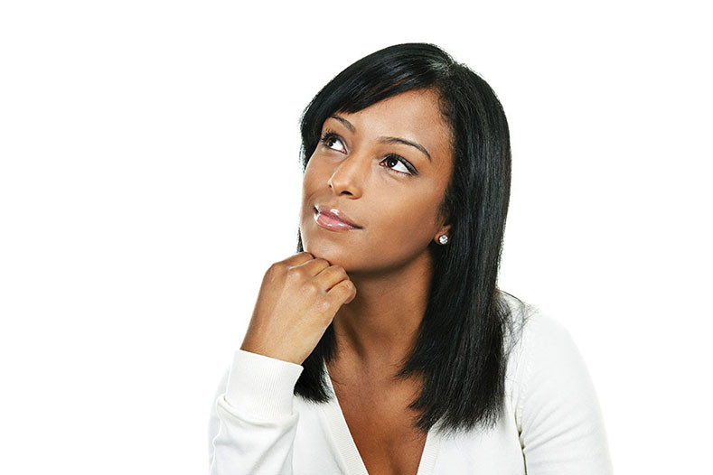 young woman stares off thinking of something