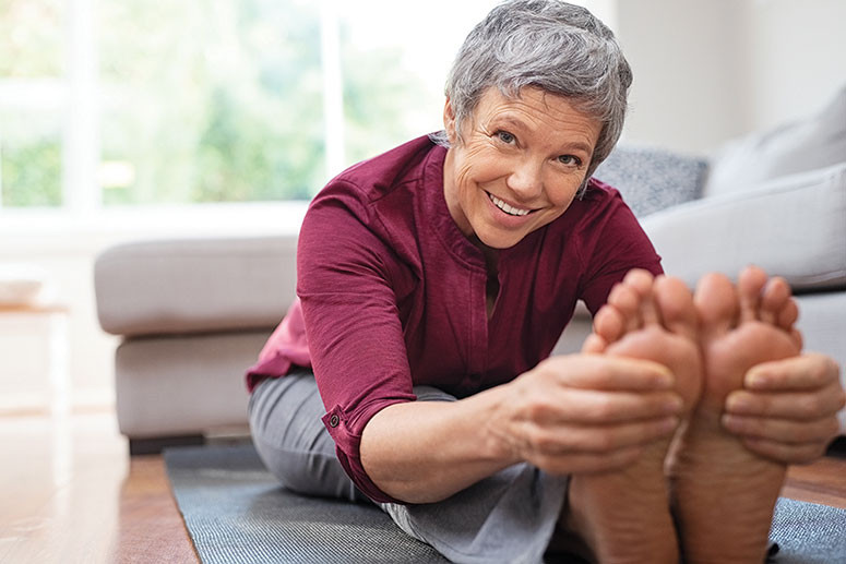 older female person shows flexibility stretching fitness plan mistakes