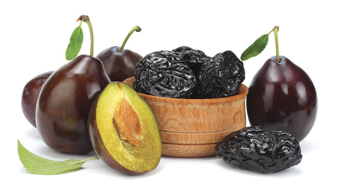 Close up of prunes and plums