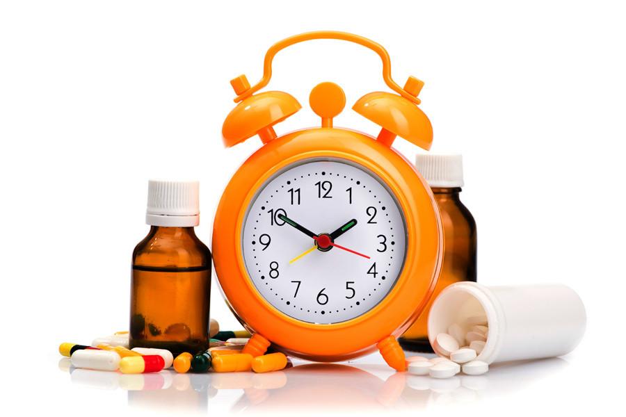 visual of alarm clock and pills