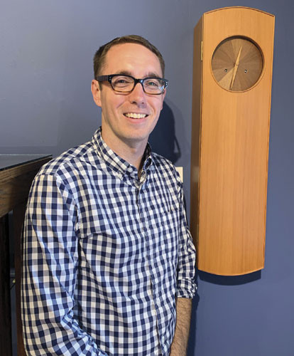 photo of russell gale and a clock on the wall