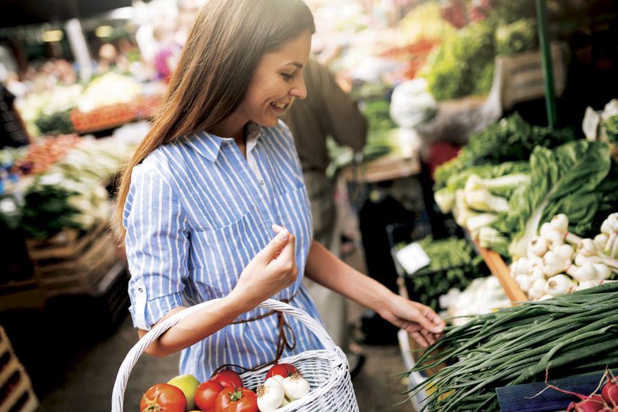 Woman shops for veg