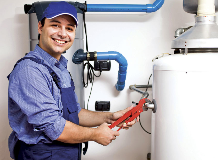 worker at water heater