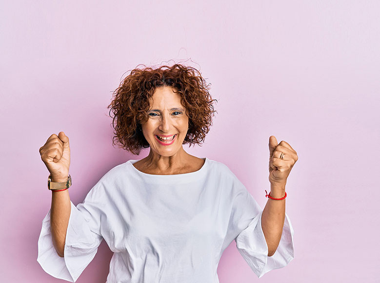 older woman hands upraised in celebration