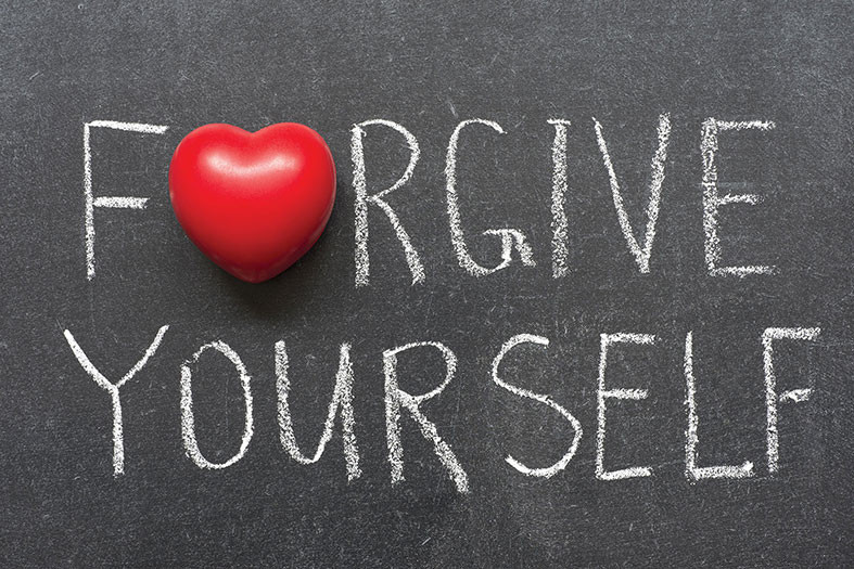 writing on a chalk board that says forgive yourself