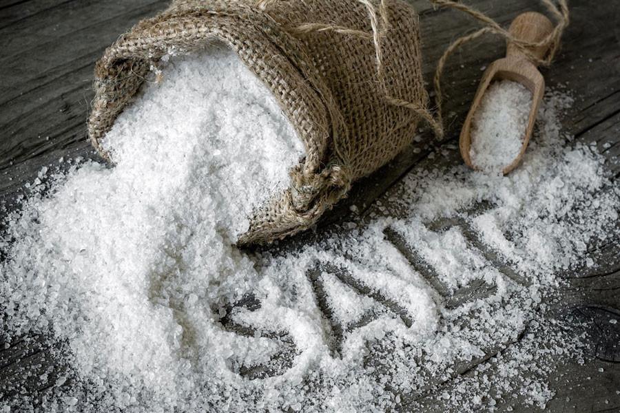 Salt spilled on wood table