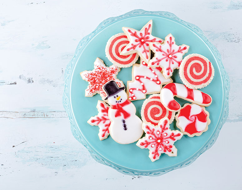 Holiday sugar cookies on a platter red decorations