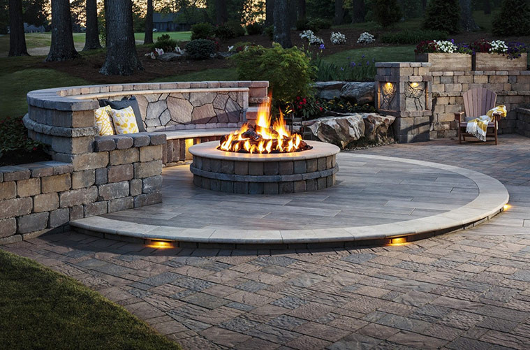 firepit with a fire burning stone design for your yard