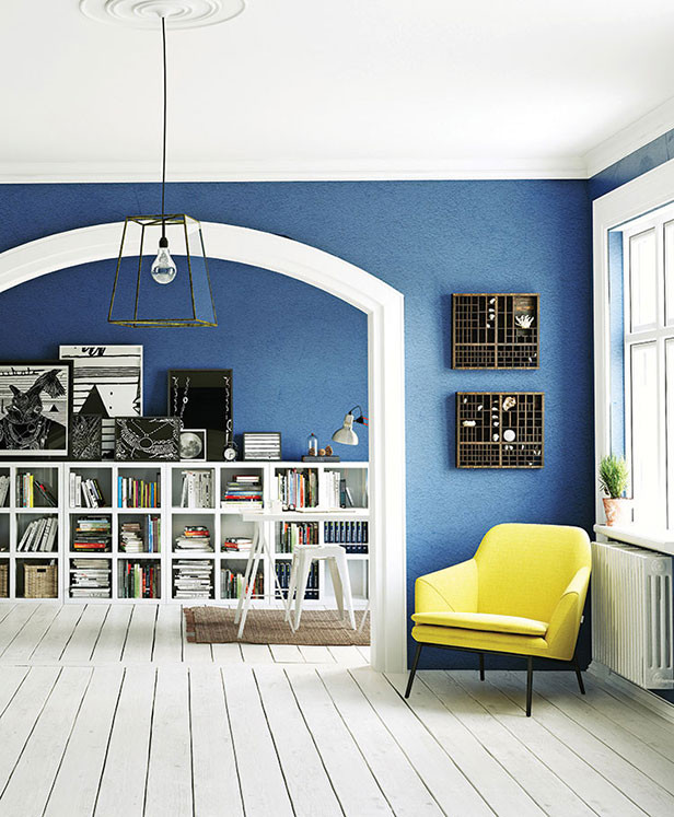 redecorated room interior with bold bright color archway white floor
