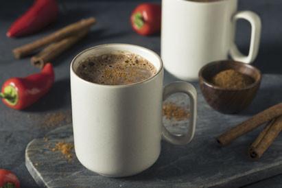 Mug of Mexican Hot Chocolate, chiles and cinnamon sticks