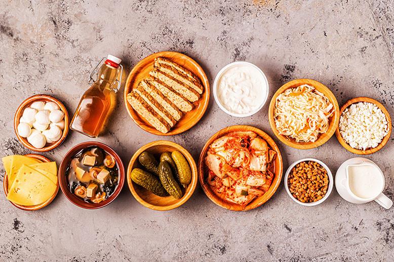 Bowls containing fermented foods probiotics kefir,kombucha,sauerkraut