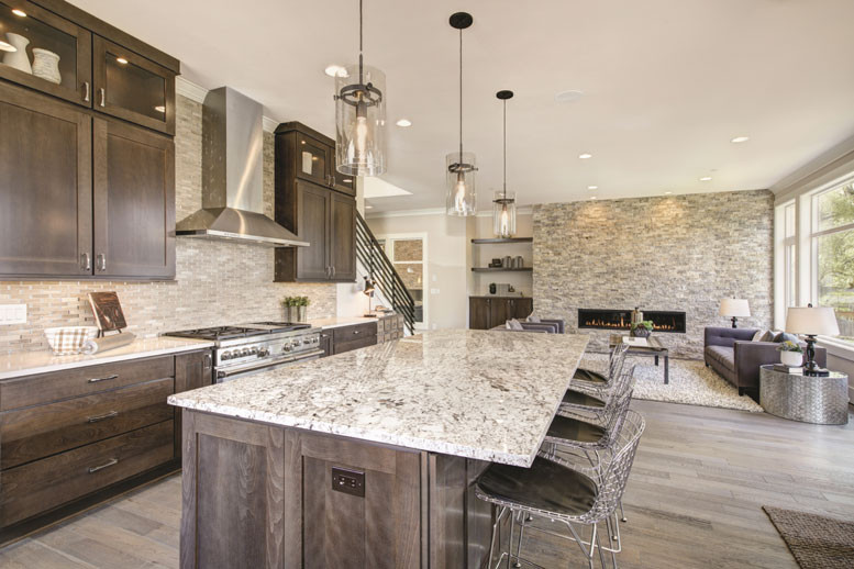wide view of massive granite kitchen counter top in massive kitchen