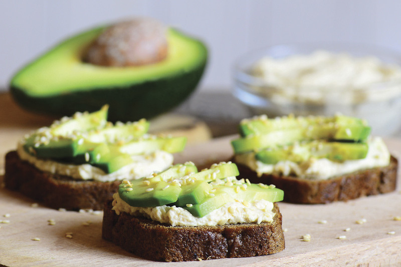 Close up of avocado slices on toast