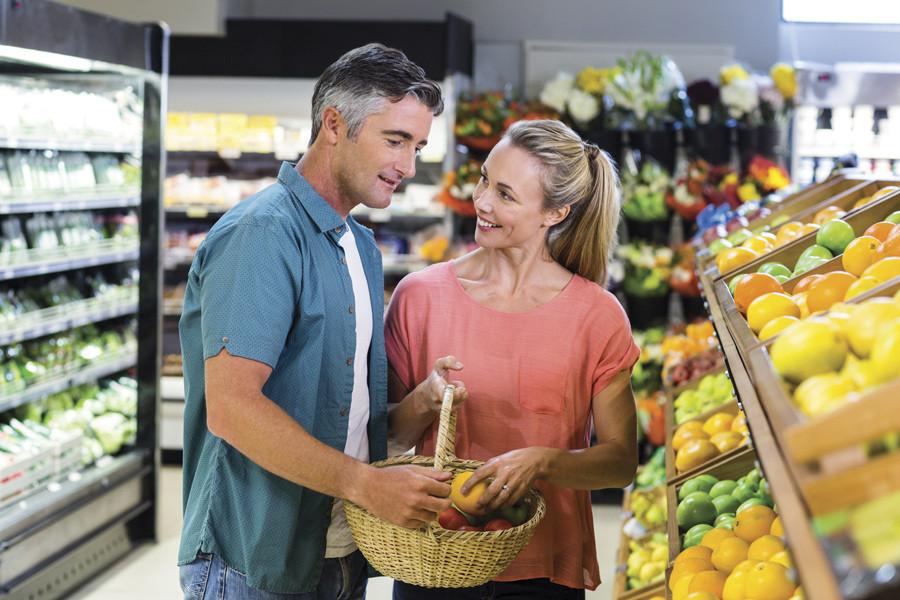 Couple shops for fruit