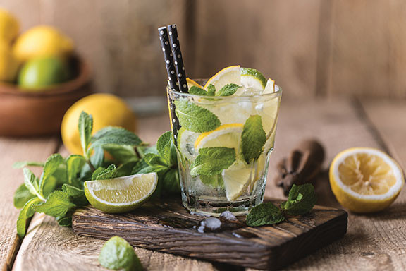 glass containing mint lemons and limes good for health
