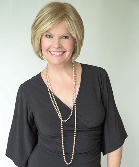 neatly dressed blond woman wearing black blouse